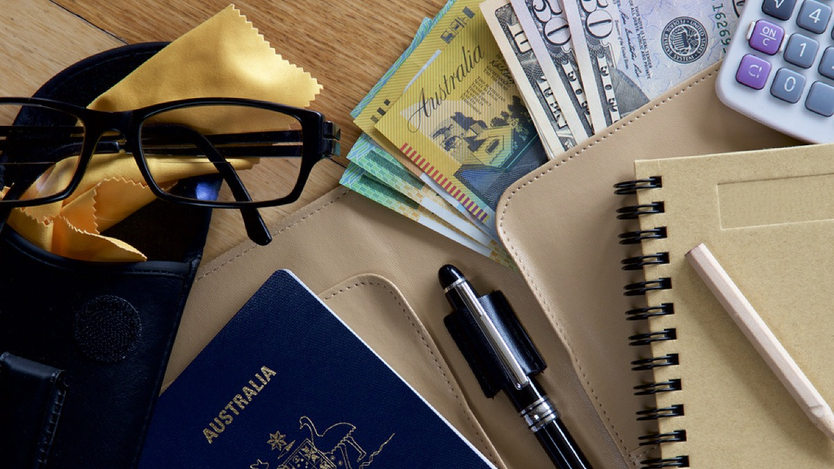 Passport, money and other travel essentials